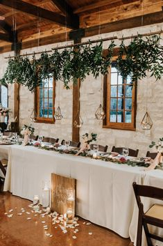 """The most elegant way to decorate your wedding head table!  Hanging greenery with geometric lanterns, floating candles + petals accompanying a wooden sign reading """"it was always you,"""" and blush bouquets with ribbons as centerpieces.  Truly a breathtaking way to decorate for your wedding reception! Photo taken at THE SPRINGS in Katy, Tuscany Hall.  Follow this pin to our website for more information, or to book your free tour! Photographer:  Kristen Curette Photography #weddingdecor…"""