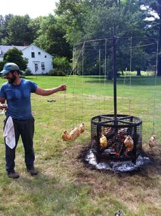 Our 'rotisserie' chicken, complete with farmer-turner!