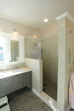 Love this shower look with cream colored subway tile., half wall with glass.