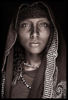 A girl from the Oromo tribe in eastern Ethiopia wears a striking, sequined headscarf (left). One day she will likely carry an umbrella to shield her from the sun like many older Oromo women. {Photographed by John Kenny} John Kenny, Black Is Beautiful, Beautiful Eyes, Beautiful World, Beautiful People, Photography Gallery, Portrait Photography, Fashion Photography, Wedding Photography