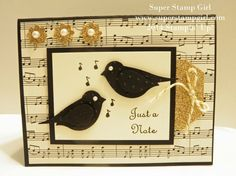 two birds in black on solid color in front of sheet music.  love the tag top sticking out of on right side
