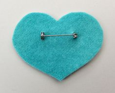 Mollie Makes - putting a pin on a brooch