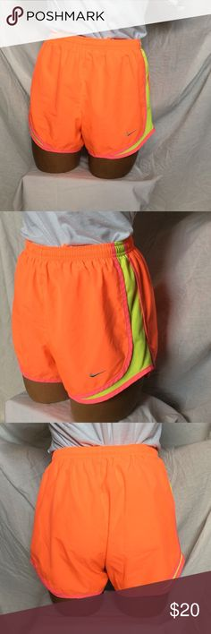 Nike Orange Dri-Fit Athletic Shorts Super cute, great condition! Have built-in underwear inside. Color is a little darker than in pictures, leaning more towards a coral orange. 100% polyester. ❤ Everything purchased on this account goes toward our Disney Family Vacation fund! Thank you so much in advance for helping to get us there! ❤ No trades! Nike Shorts