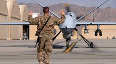File photo - A U.S. airman guides a U.S. Air Force MQ-9 Reaper drone as it taxis to the runway at Kandahar Airfield, Afghanistan March 9, 2016. (REUTERS/Josh Smith/File photo)