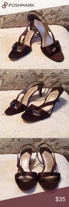 Elegant chocolate brown heels Perfect for an elegant evening or special occasion, or a fun night out!  Chocolate brown satin with a medium height heel. In excellent condition. Size 8.5 AA, but because of how open they are, they fit a medium size foot too. Talbots Shoes Heels