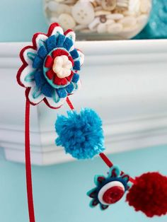 Help kids craft their own firework garland using felt, buttons, and ribbons. More fun 4th of July crafts: http://www.bhg.com/holidays/july-4th/crafts/patriotic-crafts-for-kids/?socsrc=bhgpin060112#page=1