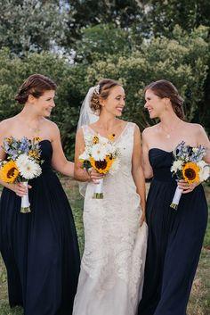 Gypsophila + sunflower themed wedding & navy blue bridesmaids for a backyard wedding