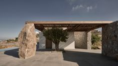Completed in 2020 in Mykonos, Greece. Images by Claus Brechenmacher & Reiner Baumann Photography. Sitting on the ridge of the hill of Aleomandra in Mykonos yet almost entirely hidden from view, Villa Mandra looks straight out to sea and the sunset. Living Divani, Wooden Table And Chairs, Studio Build, Lounge Chair, Mykonos Greece, Mykonos Island, Crete Greece, Athens Greece, Wooden Pergola