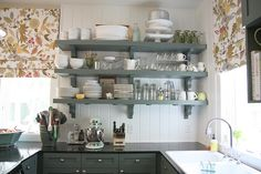 love the colors and open shelving great for small walls where cabinets will fit well.