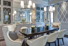 white dining room with pendant light and candle table lamps