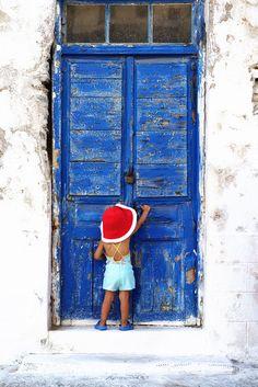 Knock knock girl, Cyclades, Greece