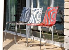 Chair with co-pressed thermoplastic seat and back on chrome sled frame.