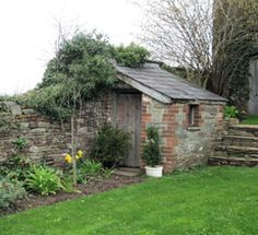 Shed for yard tools, garden, and riding lawn mower. Made of stone, wood, or durable material and moisture free.