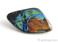 """Translucent labradorite with the best exhibit of spectral color is known in the gemstone trade as """"spectrolite"""". This spectrolite free-form cabochon is about 38 millimeters across"""