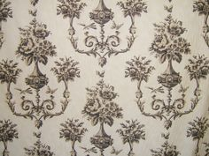 'Boutique in Cream and Brown' by Warwick, £13.99/m available from Digby and Willoughby by Honor Murray Interiors. A very popular choice at the moment.  A damask style floral pattern.