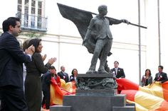 Student leaders unveil the Cesar Chavez statue in the West Mall area of campus at The University of Texas at Austin