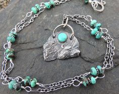 Long Silver Bear Necklace with sterling and sky blue turquoise one of a kind. $245.00, via Etsy.