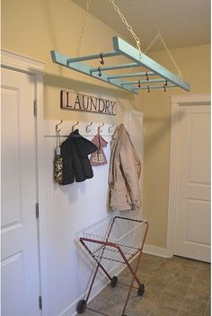 painted wooden ladder as a drying rack in the laundry room. This would work so well for me. Now I just need to find a wooden ladder! But I even have the perfect space for it to hang.