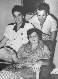 Elvis Presley sits with parents Gladys and Vernon.