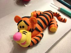 Tigger out if 1/2 gum paste 1/2 fondant , I saw this YouTube video that helped me how to make him really easy : http://youtu.be/EFnbMoRCFM4