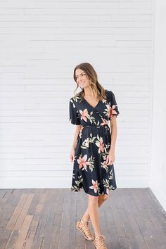 Black Floral Wrap Dress from Bella Ella Boutique    Bella Ella Boutique. Womens Online Clothing Boutique. Womens Modest Clothing Boutique. Black Wrap Dress. Floral Wrap Dress. Spring Dress. Wedding Dress. Pink Floral Dress.