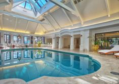 Luxurious indoor swimming pool with atrium - lake tahoe, nevada mansions ос Luxury Swimming Pools, Luxury Pools, Indoor Swimming Pools, Dream Pools, Swimming Pool Designs, Lap Swimming, Luxury Cars, Inside Mansions, Mansions Homes