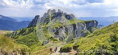 Hiking around the famous rock formation in Ciucas mountains, part of the Romanian Carpathians.