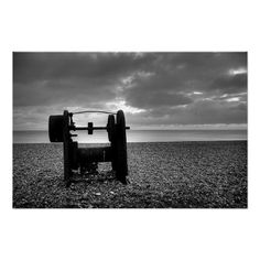 Winch :- An old winch sits on Brighton beach having seen better days. Now it's all rusted up and out of use but at one time it will have been oiled and and working hard to pull boats up out of the water and up onto the pebbled beach. #winch #beach #old #worn #disused #rusted #weathered #forgotten #discarded #sea #horizon #monochrome #blackandwhite #brighton