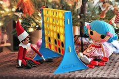 Playing Connect Four | 43 Awesome Elf On The Shelf Ideas To Steal This Christmas