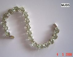 MJB-5: Fine Peridot stones in sterling silver bracelet. Buy it here for $ 100.50, mail us at nirwan.exports@gmail.com