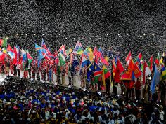 Athletes from all 204 nations flood into the stadium simultaneously