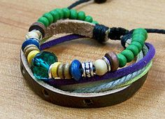 Charm leather bracelets  --green wood bead and green glass bead,blue rope,adjustable length-for men and women. $6.99, via Etsy.