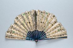 Dyed mother of pearl fan, the leaf shaped and decorated to resemble a butterfly