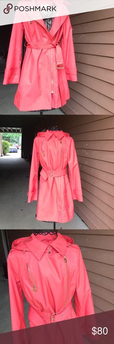 Pre-Owned MIchael Kors Trench RainCoat Women Small In good condition. Ask question before purchasing. I've had this jacket for many years and always for compliments when I wore it. Features a coral coral throughout the whole coat with Gold trimming, front zip closure, adjustable & removable belt. Mk logo throughout interior of the jacket and slit in the middle of the back. Beautiful jacket! Reasonable offers will be considered. MICHAEL Michael Kors Jackets & Coats Trench Coats