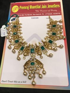 70 GMs net gold nekclace studded with emeralds and uncuts. Necklace having dancing peacock design pendant. Necklace with south sea pearl hangings. 09 May 2018 Indian Jewelry Sets, Indian Wedding Jewelry, Bridal Jewelry, Gold Jewellery Design, Bead Jewellery, Latest Jewellery, Pearl Jewelry, Gold Jewelry, Peacock Design