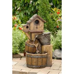 @Overstock.com - Rustic Bird House Outdoor Water Fountain - This distressed bird house fountain will add a rustic style to your backyard. Water falls from the top basin into a collection basin, and when it's full, water flows into the central basin below.  http://www.overstock.com/Home-Garden/Rustic-Bird-House-Outdoor-Water-Fountain/8225644/product.html?CID=214117 $142.99