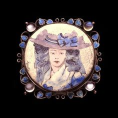 This is not contemporary - image from a gallery of vintage and/or antique objects. GEORGE HUNT (1892-1960)  A silver brooch set enamelled portrait of a lady,  the enamel within a wirework frame of leaves and moonstones.