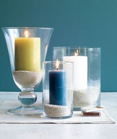 Double-duty decor: sand as candle holders.