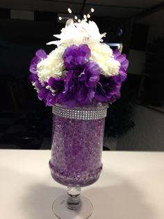 wedding centerpiece with purple water beads, metallic silver rhinestone white and purple flowers with pearls.