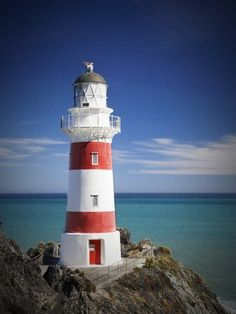 VERIFIED:,Location: Cape Palliser Lighthouse (C Palliser named by Cpt. Cook after one of his R Navy mates) , South Wairarapa, at the very Southern tip of the North Island, and 50kms East of the entrance to Wellington Harbour. Built in 1897, it plays a vital part in the safe navigation of Cook Strait, between New Zealand's North and South Islands. . The Cape Palliser Lighthouse is an unmanned lighthouse blinking once every 20 seconds. It is also home to a permanent fur seal colony. Cape…