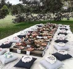 Boho outdoor tablescape with floor cushions