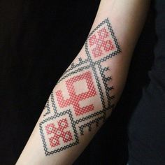 Cross stitch tattoos are gaining in popularity.
