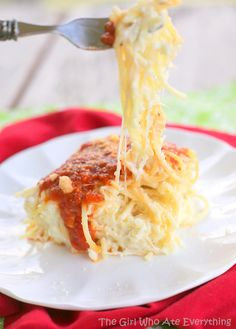 Baked Spasagna - Is it spaghetti? Is it lasagna? It's….both. Just imagine spaghetti noodles mixed with the same yummy ricotta mixture that is usually found in the layers of lasagna.  http://www.the-girl-who-ate-everything.com/2013/05/baked-spasagna.html