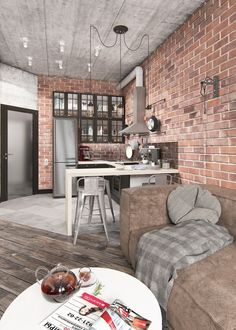 Without much space for extraneous decoration, the open living room instead relies on texture. Exposed brick and weathered wood feel rustic compared to the urban vibe of the concrete.