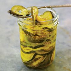 Squash Pickle Medley Recipe with zucchini, yellow squash, onions, canning and pickling salt, ice cubes, white vinegar, sugar, mustard seeds, celery seed, ground turmeric