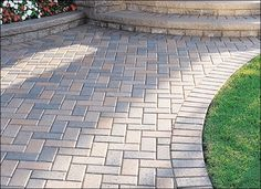 Holland stone in 90 degree herringbone pattern with a soldier course border for back patio