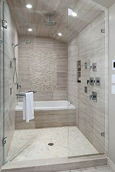 I love how the tub is inside the glass shower, such an oasis.