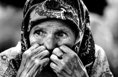 Elderly Bosnian Refugee Crying.Tuzla, Bosnia - Herzegovina   A woman who has arrived from Srebrenica sits quietly sobbing outside a refugee shelter. In 1995 no ethnic group in Bosnia remained untouched by anguish and upheaval. The Serbian conquest of the enclaves of Srebrenica and Zepa - which underscored UN impotence to guarantee their safety - triggered a mass exodus to the last remaining Muslim strongholds. Faced with a Croatian offensive, Serb inhabitants of the Krajina …