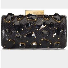 """🎉HP🎉 Michael Kors Collection Rana Jeweled Clutch Michael Kors Collection black snakeskin embossed leather & black faceted crystal jeweled barrel clutch/shoulder bag with chain strap that can be neatly tucked in bag when not in use. Measures approximately 6 3/4"""" long x 3 1/4"""" high x 2 1/4"""" deep. Worn once and in  excellent condition with felt dust bag. A perfect show stopping evening/holiday accessory! Michael Kors Bags"""