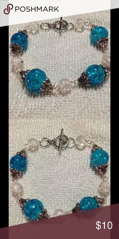 """Blue & White Glass Bead Bracelet This beautiful piece is made with sparkling blue and white glass beads and has a toggle clasp. It will fit up to a 7.5"""" wrist. This bracelet and all PeaceFrog jewelry items are made by me! PeaceFrog Jewelry Bracelets"""